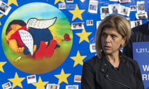 Canadian Tima Kurdi, aunt of Aylan Kurdi, reacts in front of a painting depicting the drowned Syrian child during a demonstration in Brussels<br>