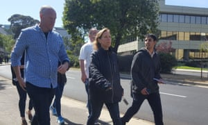 Susan Wojcicki, YouTube's CEO, exits the building after the shooting was reported.