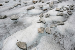 Rocks and debris litter the surface of the glacier