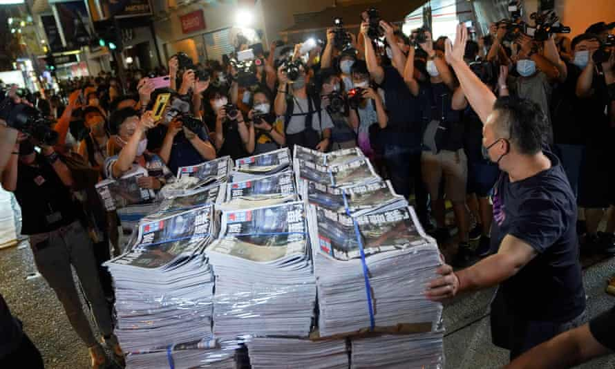 Copies of the final edition of Apple Daily in Hong Kong.