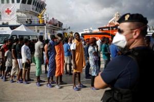 Augusta, Italy: Migrants disembark from the vessel Topaz Responder