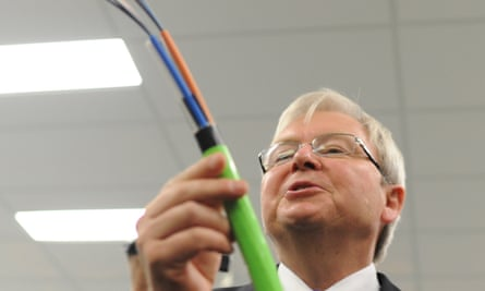 Kevin Rudd looks at a fibre optic cable