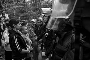 """Police clash with demonstrators of the pacific resistance group """"La Puya"""", after they bhad spent months blocking a US mining company in San Jose del Golfo, Guatemala."""