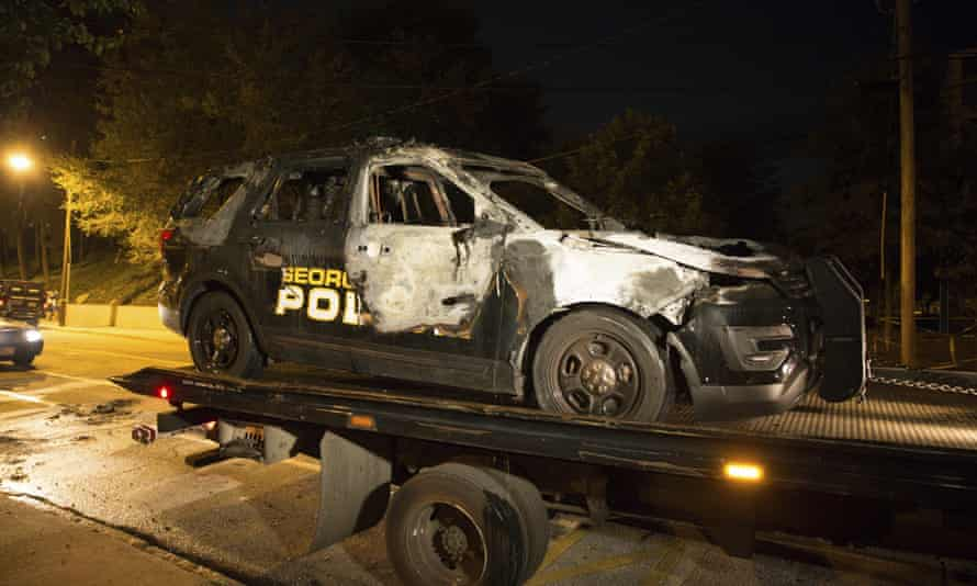 A truck loads a burned Georgia Tech police vehicle in front of the police station on campus in Atlanta on Monday.