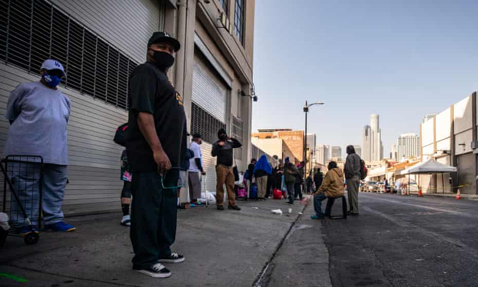 Homeless people waiting to receive food and basic necessities in Los Angeles, California.