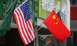 US and Chinese flags  displayed outside a hotel in Beijing