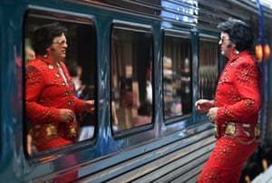 Elvis impersonator John Collins looks at his reflection before boarding the Elvis Express