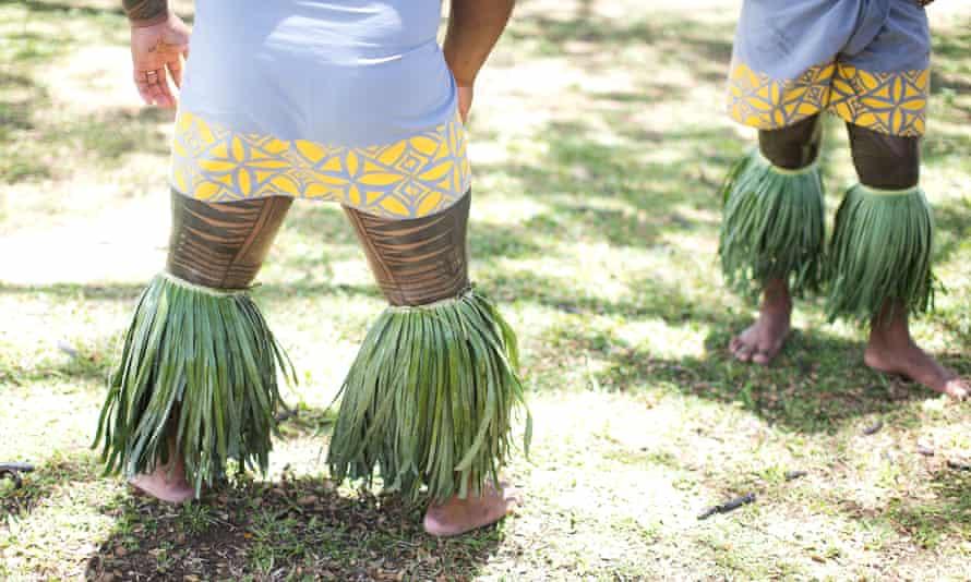 Samoan dancers bearing traditional tattoos