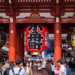 Tourists at Senso-ji temple, Asakusa, Tokyo.