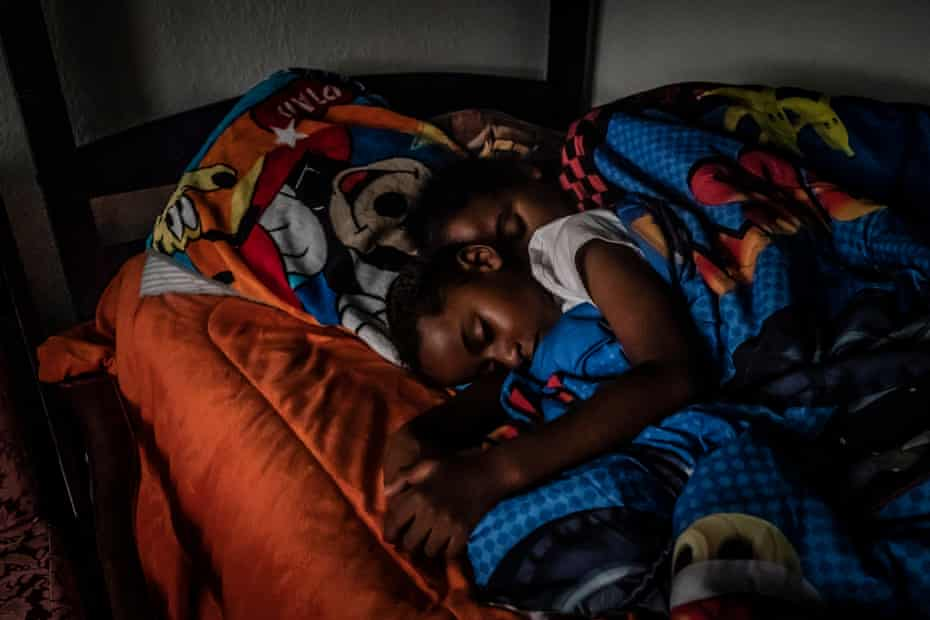 Cherokeena Robinson, 32, lays in bed with her son Mai'Kel Stephens, 6, at their transitional house in San Pedro, California that they share with one or two other families at a time. Cherokeena lost her teaching job during the pandemic and now relies on the organization Family Promise to help with housing, childcare, food, and counseling. Cherokeena and her son have been living in the transitional house since June 2020 where she pays $300 a month for rent for a private room until she can figure out her job and find a full private apartment of her own.