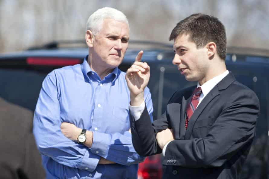 Mike Pence speaks to Pete Buttigieg following a Dyngus Day event in South Bend, Indiana in 2013.