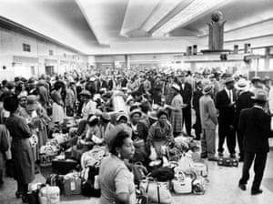 West Indian people wait in the customs hall at Southampton in June 1956