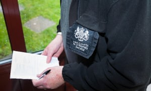 'A safe home provides the infrastructure necessary for people affected by coronavirus to get back on their feet.' A bailiff delivers an eviction notice.