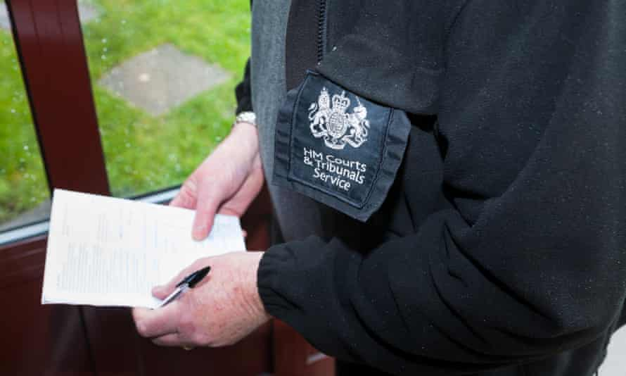 A bailiff serving an eviction notice