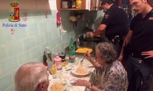 Italian police with a lonely older couple
