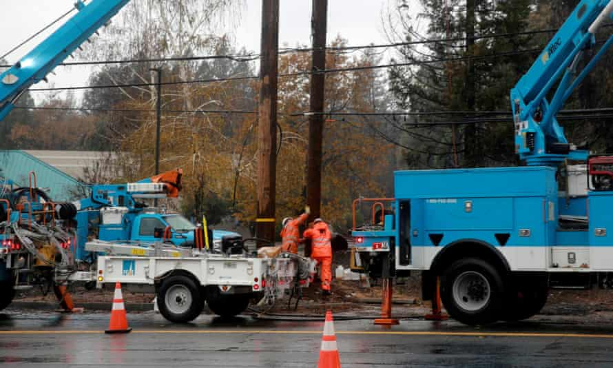 PG&E works on power lines to repair damage caused by the Camp fire in Paradise, California.