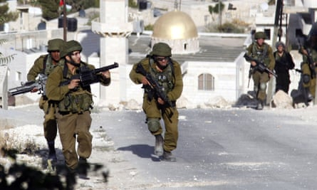 Israeli soldiers clash with Palestinians, out of picture, in the West Bank village of Tekoa on Thursday.