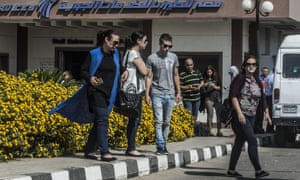 Relatives of passengers who were flying in an EgyptAir plane that vanished from radar en route from Paris to Cairo leave a services hall at Cairo airport.