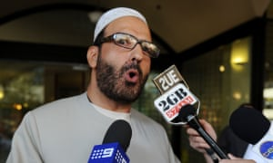 Man Haron Monis talks to the media after a court appearance.