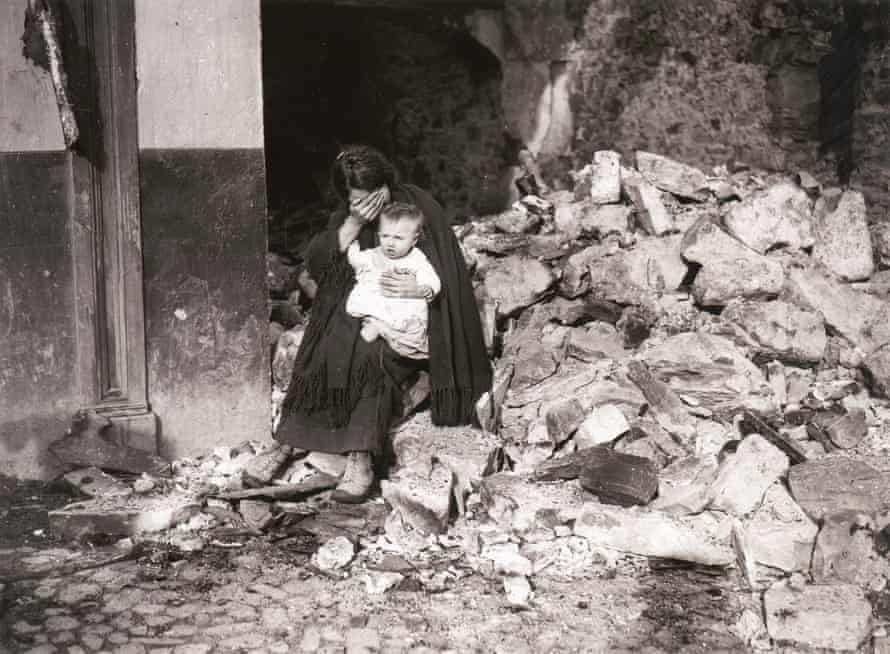 Irish civil war, Dublin, June or July 1922 … a woman sitting amid rubble, with a baby on her lap