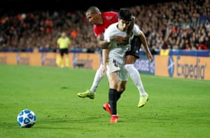 Valencia's Carlos Soler tussles with Manchester United's Ashley Young.