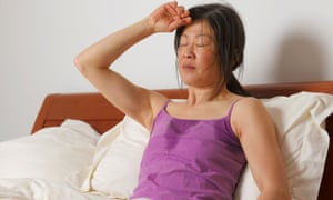 A woman suffering from night sweats