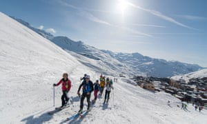 ski tourers walk up the slope from Val Thorens