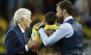 Gareth Southgate comforts Mateus Uribe.