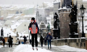 A woman cross-country skis across the medieval Charles Bridge in Prague, Czech Republic