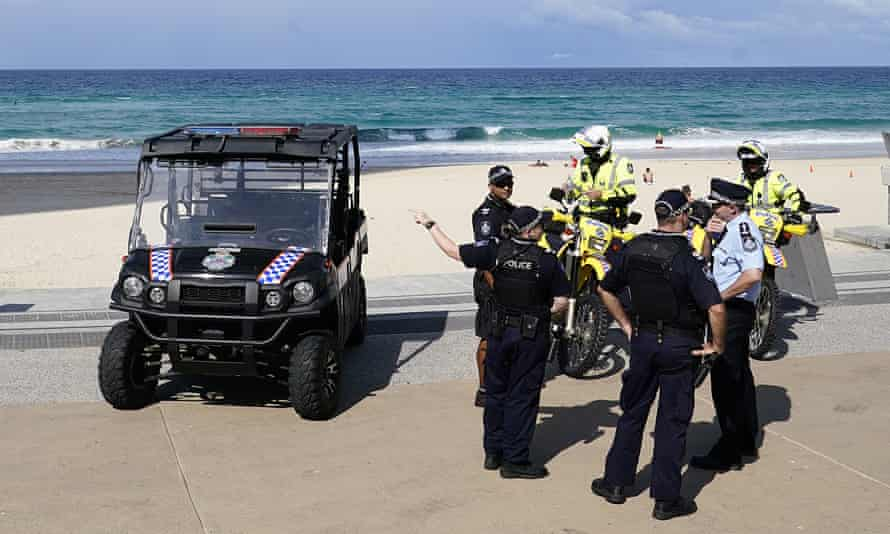 Queensland police gather at Surfers Paradise Beach on the Gold Coast on Thursday.