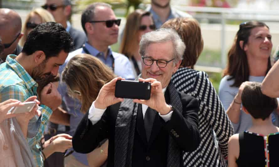 Steven Spielberg takes photos with his iPhone at this year's Cannes film festival.
