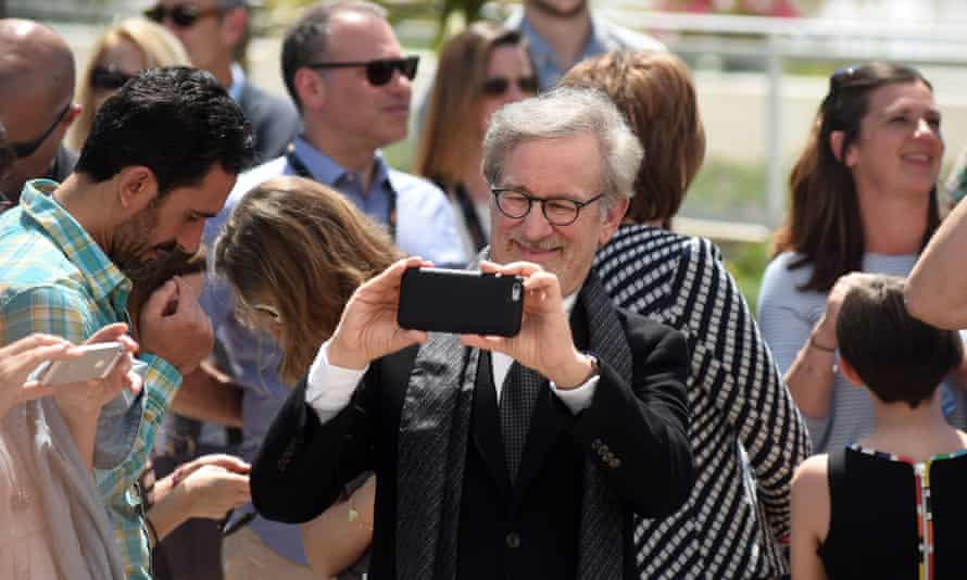 A rare example of an older person using an iPhone to take photographs.