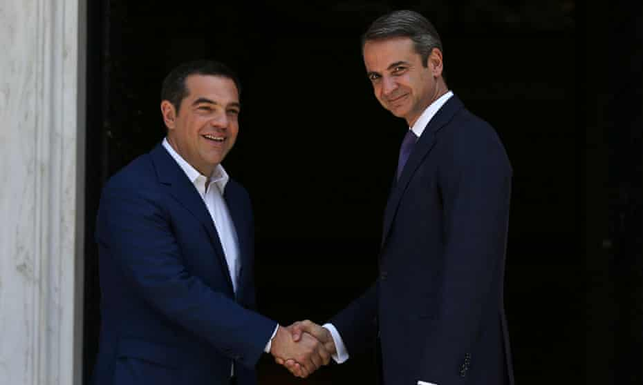 Newly-appointed Greek prime minister Kyriakos Mitsotakis (right) with the outgoing leader Alexis Tsipras in Athens.