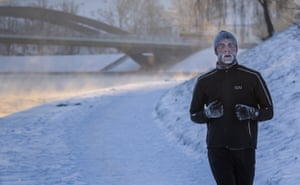<strong>Vilnius, Lithuania</strong><br>A man with frost on his face runs along the banks of the Neris river as temperatures dipped to -18 degrees Celsius