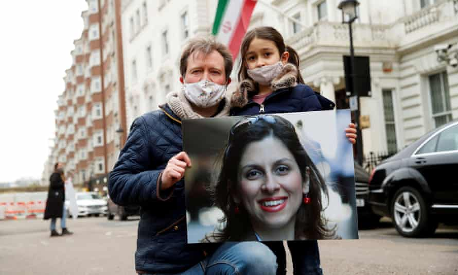 Richard Ratcliffe, husband of Nazanin Zaghari-Ratcliffe, and their daughter Gabriella protest outside the Iranian embassy in London