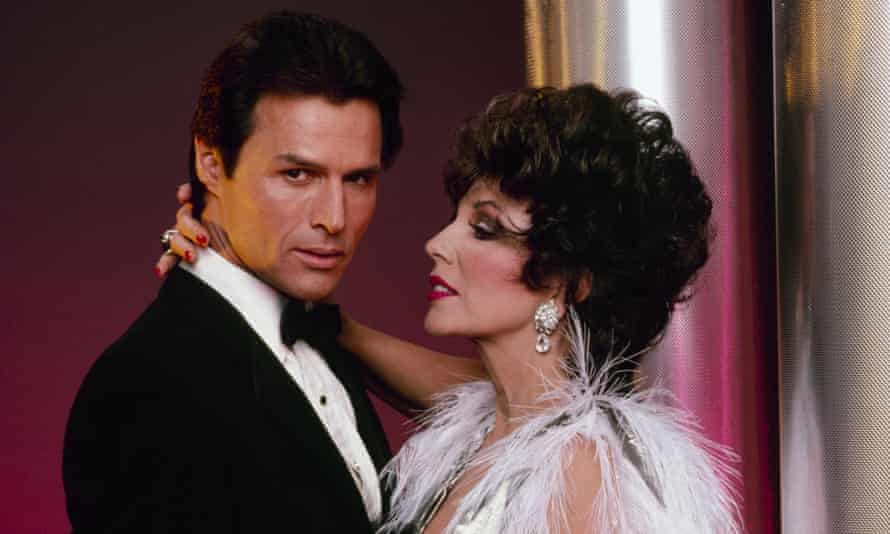 Michael Nader with Joan Collins in a scene from Dynasty, 1985.