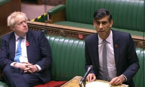 Boris Johnson (left) listens as Chancellor Rishi Sunak gives an update of the economy in the House of Commons in London on 5 November.
