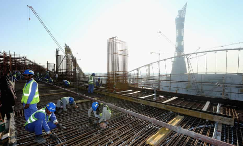 Construction workers pictured at the Khalifa International Stadium being prepared for the 2022 World Cup.