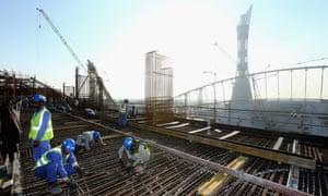 Construction workers at the Khalifa International Stadium ahead of the 2022 FIFA World Cup Qatar
