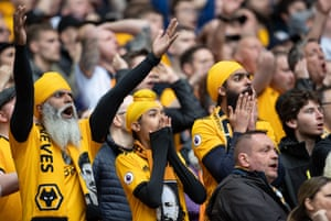Wolves fans celebrate as Matt Doherty heads home to score the opening goal in the first half.