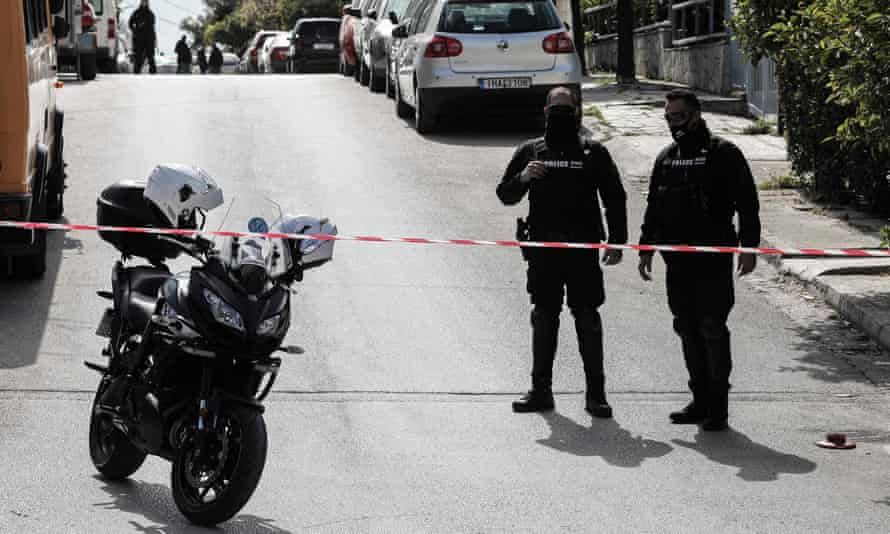 Police block the road in a southern suburb of Athens where journalist Giorgos Karaivaz was shot on 9 April.