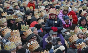 People watch the Epiphany parade in Warsaw, Poland