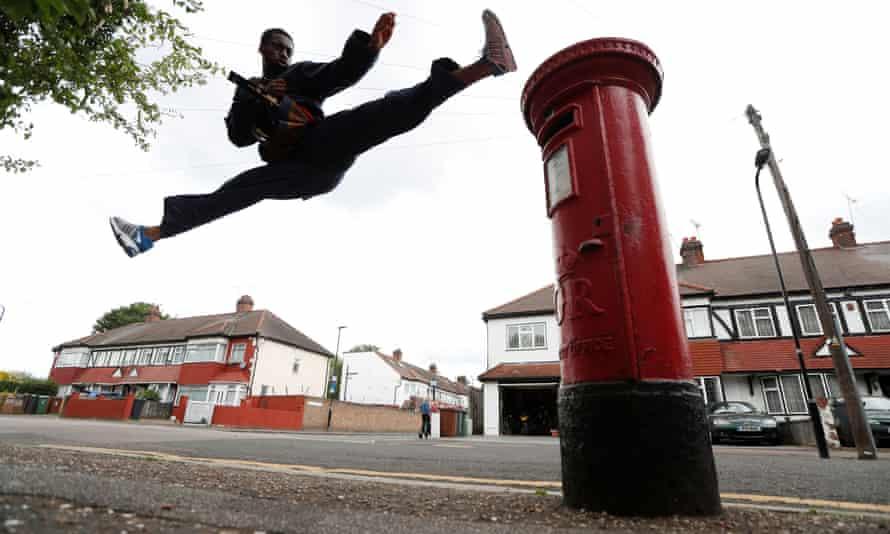 Team GB taekwondo athlete Lutalo Muhammad trains at his home.
