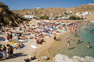 People bathing at Super Paradise Beach, Mykonos, Greece