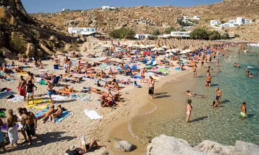 People on a beach in Mykonos, Greece