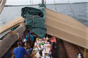 Nurse Kalu Harrison and his team are putting the medicines in order on the boat