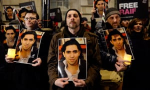 Protesters in front of the Saudi embassy in London campaign against the flogging of the Saudi blogger Raif Badawi.