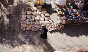 Girl walking in a market in Morocco