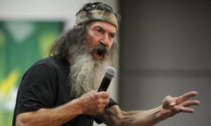 Duck Dynasty's Phil Robertson fires up the crowd for Cruz during a campaign event in Sioux City, Iowa.