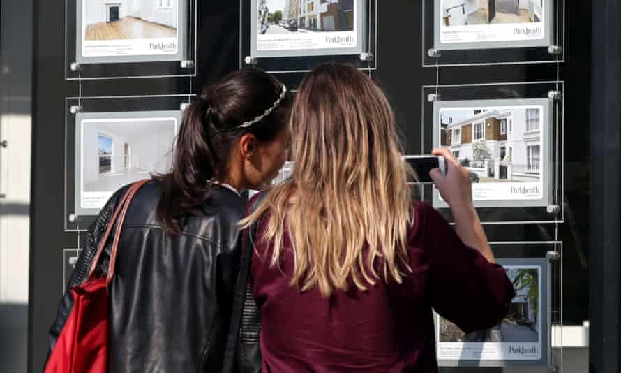 Women looking at property adverts